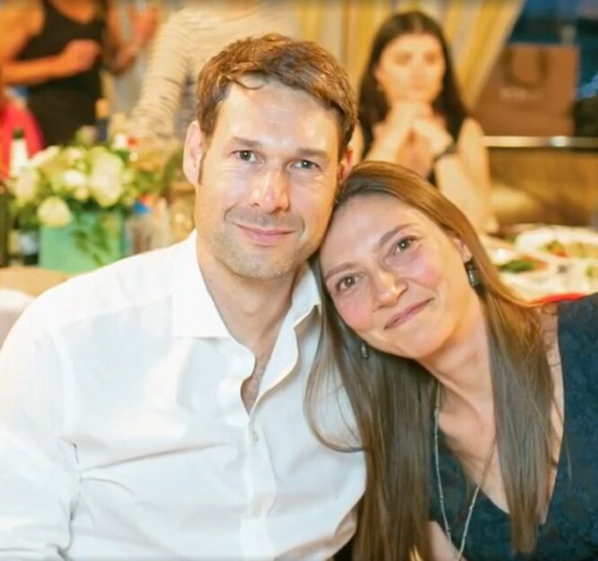 The granddaughter of Yuri Nikulin is Maria.  The girl's husband Dominic is nearby